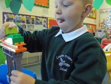 Tyler building a robot.