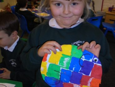 Our topic this term is colour. We are learning to write the story Elmer. Here is Evie's painting of Elmer.