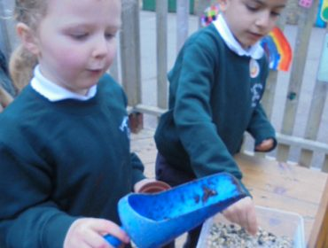 We are learning about plants this term, here we are exploring the planting area. We are potting up seeds and writing labels.
