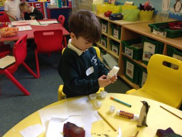 Making a penguin from craft materials.