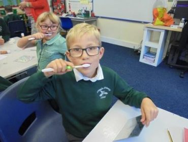 Jude and Evie know how to brush their teeth effectively.