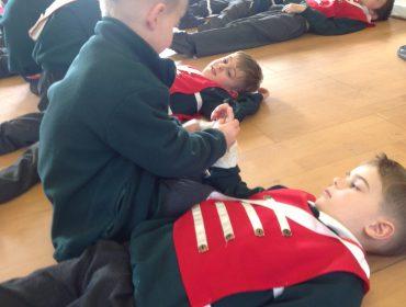 I am putting on a bandage on Mason's arm.